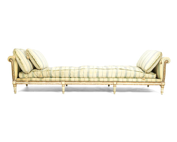 A very long French 19th century painted and parcel gilt daybed