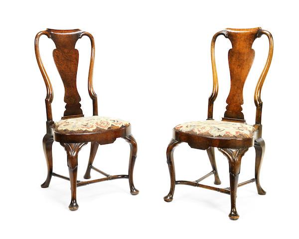 A set of six Edwardian walnut dining chairs