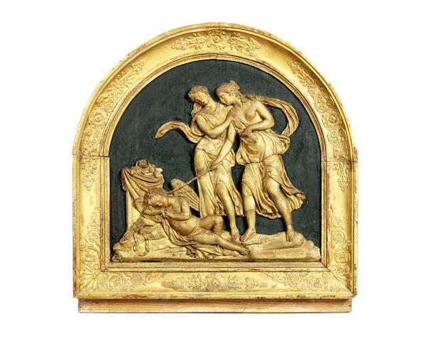A late 18th / early 19th century gilt composition figural relief depicting Cupid and Psyche