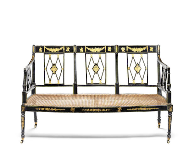 A late George III ebonised and parcel gilt decorated triple chairback settee