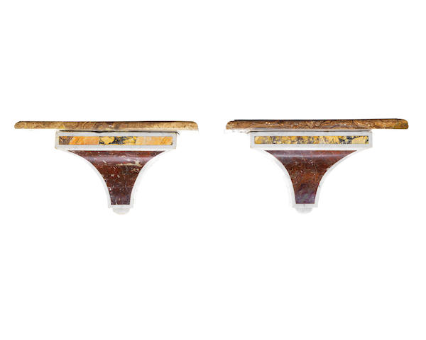 A pair of 19th century and later marble wall brackets
