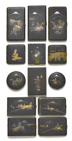 A group of gold and silver inlaid damascened iron cases