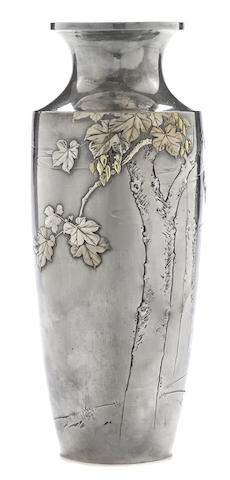 A silver vase with gilt accents