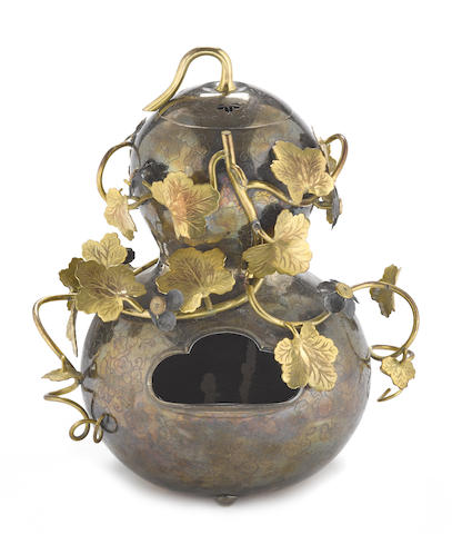 A silver double-gourd form vessel