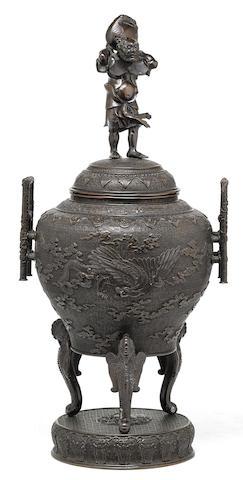 A large patinated bronze tripod urn