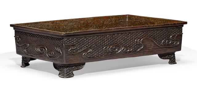 A patinated bronze flower arranging vessel, suiban