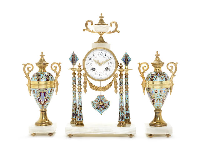 A late 19th century French gilt brass, champleve enamel and onyx clock garniture