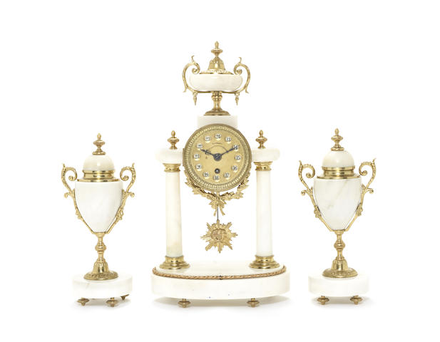 A very rare late 19th century French mantel timpiece garniture with automatic jumping 24-hour dial
