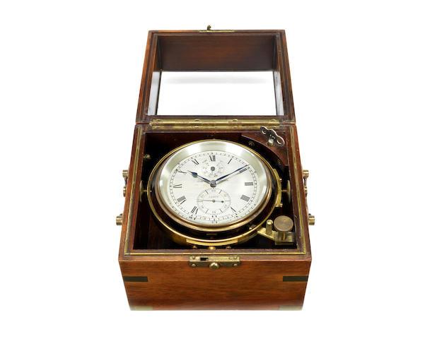A brass marine chronometer