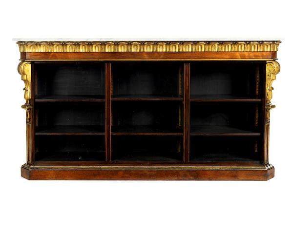 A 19th century rosewood and parcel gilt low open bookcase