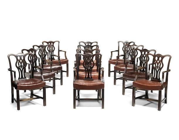 A set of twelve Edwardian mahogany open armchairs