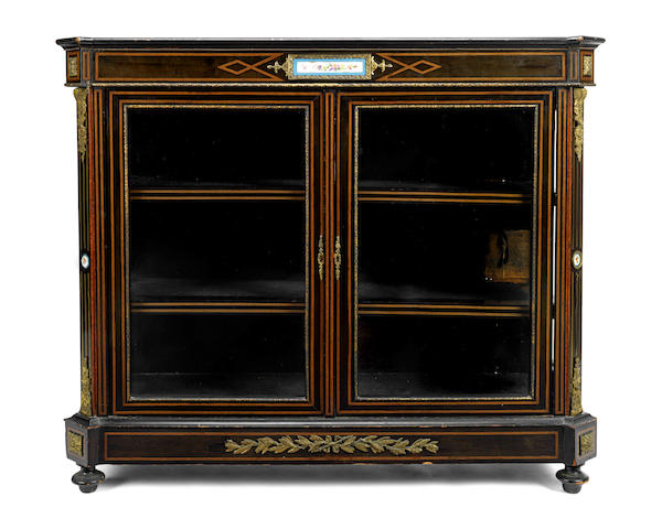 A mid Victorian porcelain mounted ebonised low display cabinet