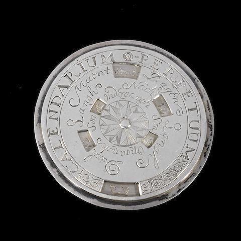 A 17th century silver perpetual calendar disc