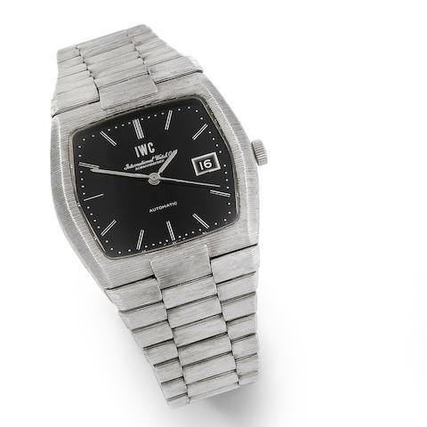 IWC. A heavy 18K white gold automatic calendar bracelet watch