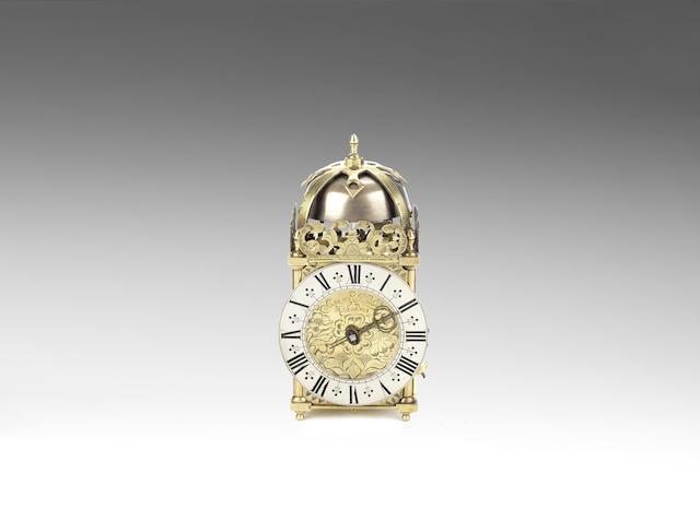 A late 17th century miniature brass lantern clock