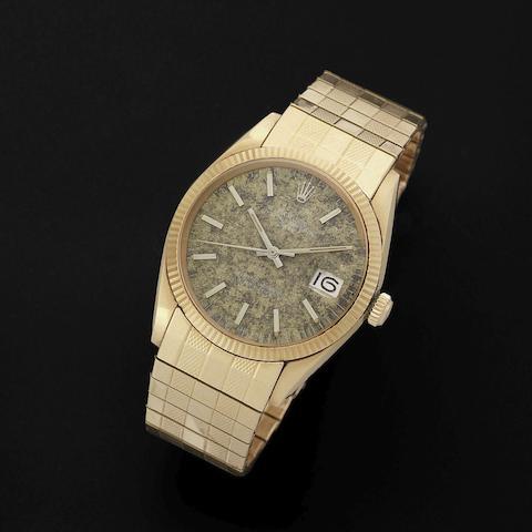 Rolex. An 18K gold automatic calendar bracelet watch with unusual