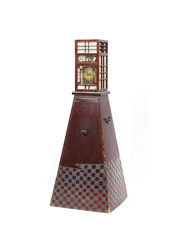 An early 19th century Japanese lacquered iron Yagura Dokie clock with stand and hood