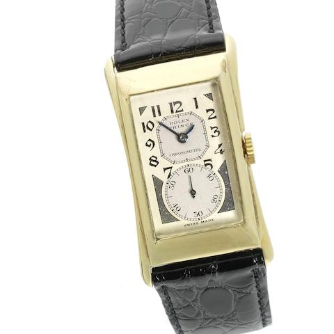 Rolex. A 14K gold manual wind rectangular wristwatch
