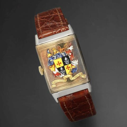 A steel and 9K gold manual wind reversible wristwatch with painted coat of arms