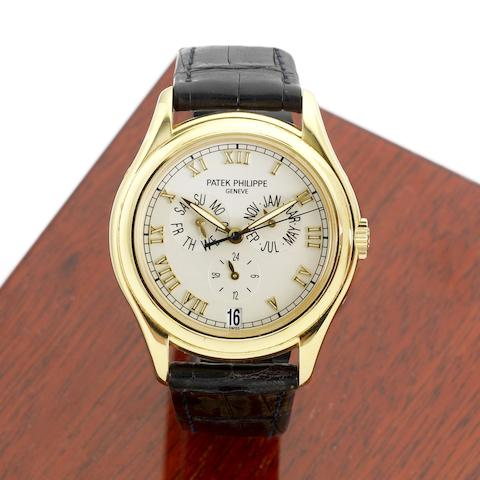 A fine 18K gold automatic annual calendar wristwatch with 24 hour indication