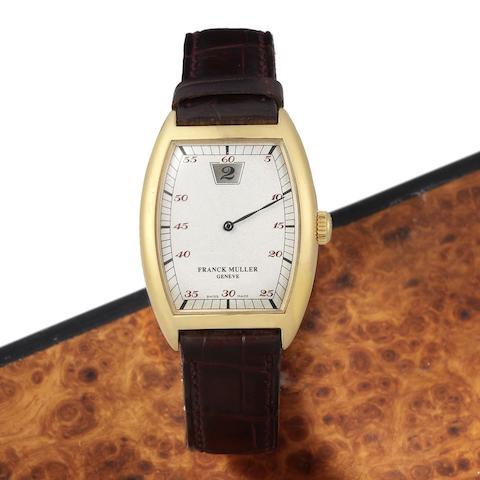 An 18K gold manual wind jump hour wristwatch