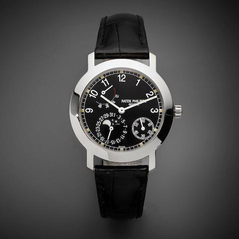 A fine 18K white gold automatic calendar wristwatch with moon phase and power reserve