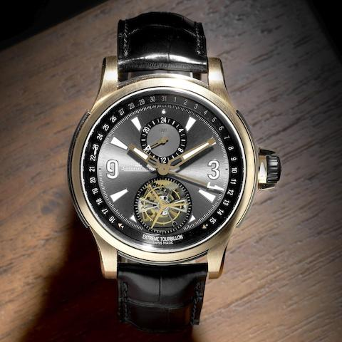 A limited edition 18K rose gold and titanium automatic tourbillon calendar wristwatch with dual time-zone
