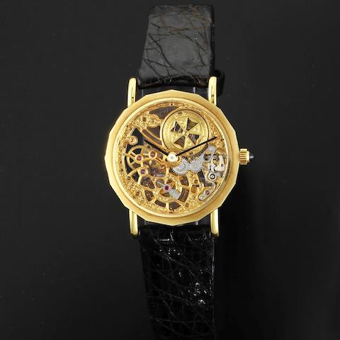 A lady's 18K gold manual wind skeletonised wristwatch