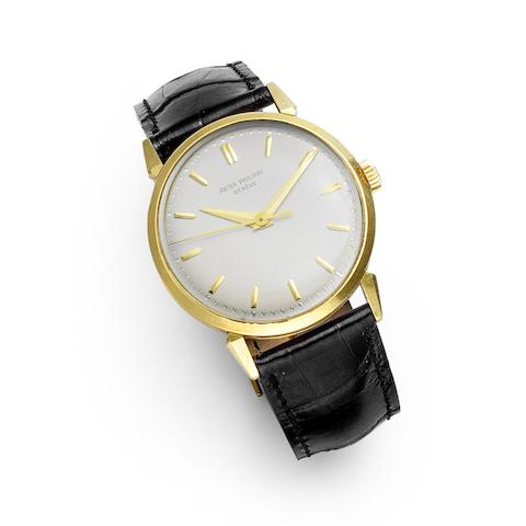 An 18K gold manual wind wristwatch with faceted lugs