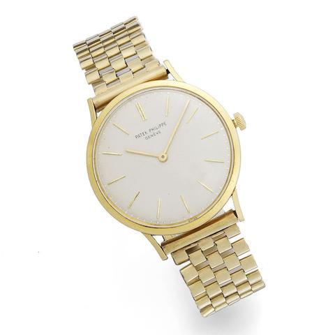 An 18K gold manual wind bracelet watch