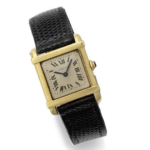 Cartier. An 18K gold manual wind wristwatch
