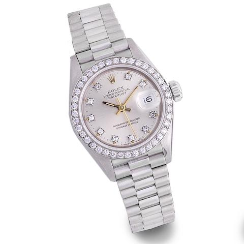 Rolex. A lady's 18K white gold and diamond set automatic calendar bracelet watch