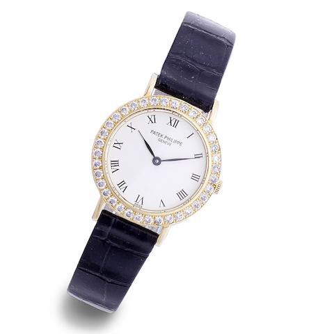 A lady's 18k gold and diamond set quartz wristwatch