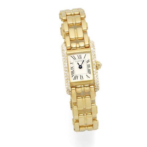 Cartier. A lady's 18K gold and diamond set quartz bracelet watch