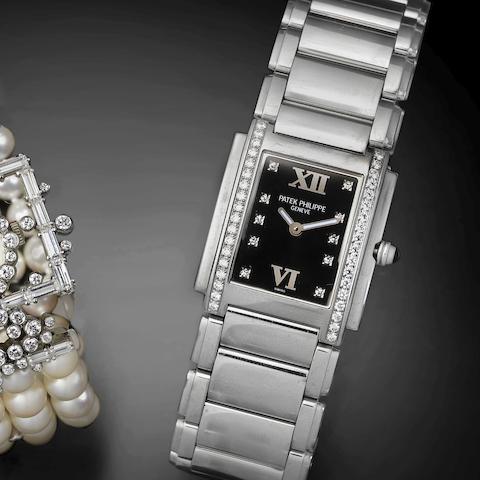 A lady's stainless steel and diamond set quartz bracelet watch