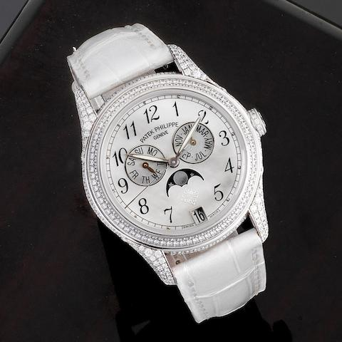 A very fine 18K white gold and diamond set automatic annual calendar wristwatch with moon phase