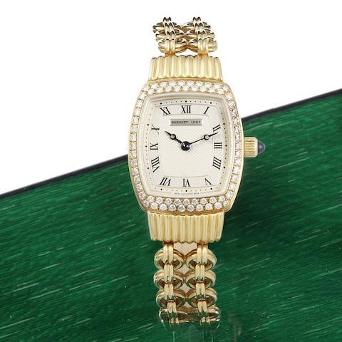 Breguet. A lady's 18K gold and diamond set manual wind bracelet watch