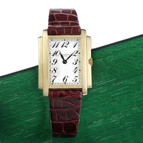 A lady's 18K gold quartz rectangular wristwatch