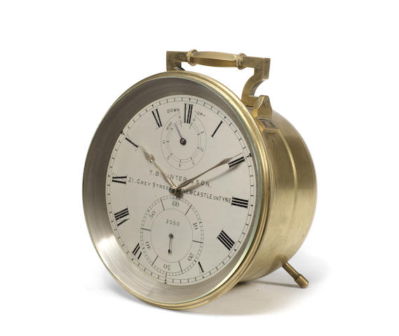 A 19th century eight-day marine chronometer adapted to a freestanding travelling clock