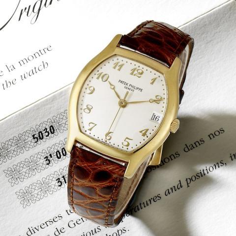 An 18k gold automatic calendar wristwatch