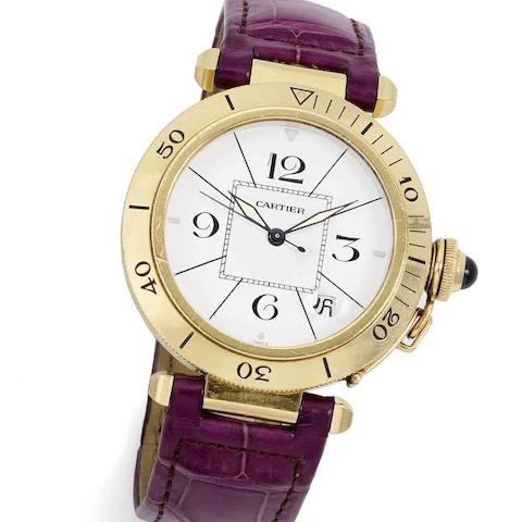 Cartier. An 18K gold automatic calendar wristwatch