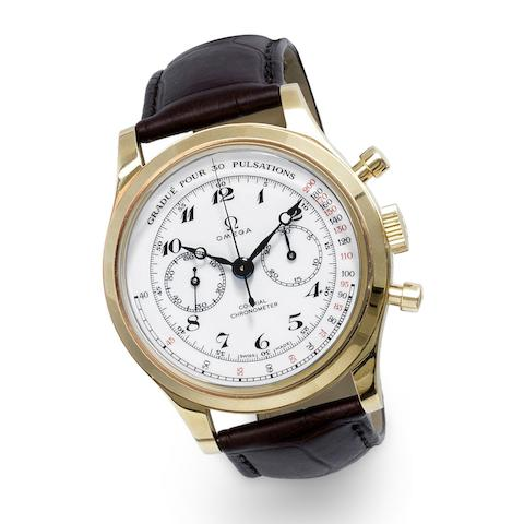 Omega. An 18K gold manual wind co-axial chronograph wristwatch