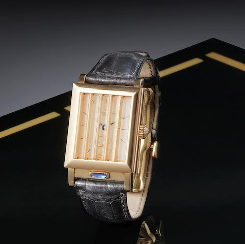 A fine and unusual 18K rose gold manual wind rectangular shutter wristwatch with concealed dial