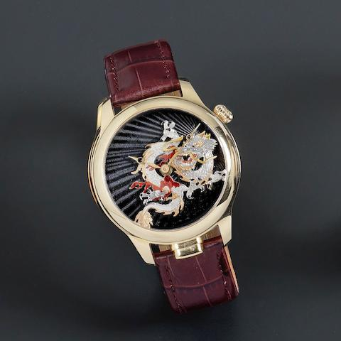 Nivrel. An 18K gold manual wind five minute repeating automaton wristwatch