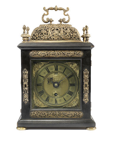 A late 17th century ebony basket top quarter repeating table timepiece