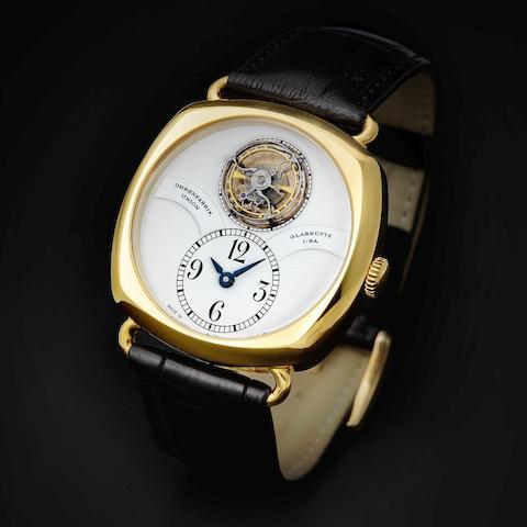 Union. An 18K rose gold manual wind wristwatch with tourbillon escapement