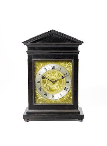 A fine and rare mid 17th century ebony veneered architectural turntable bracket clock