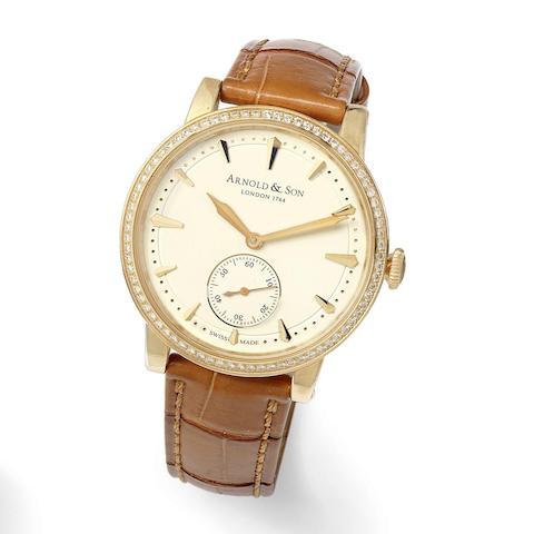 An 18K rose gold and diamond set manual wind wristwatch