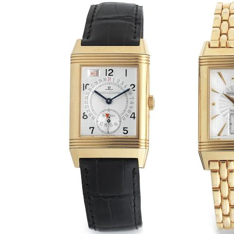 An 18K rose gold manual wind reversible calendar wristwatch