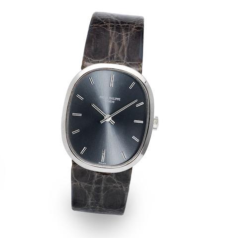 A mid size 18K white gold manual wind wristwatch